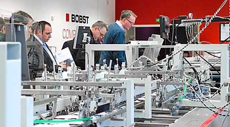 Visitors to BOBST's Partners in Productivity open house watch a demonstration of techniques used in benchmarking.