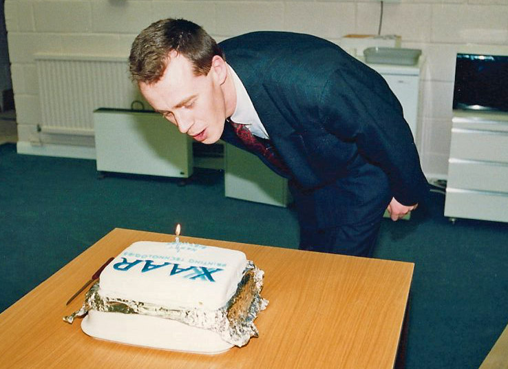 Xaar 1st birthday celebration. Mark Shepherd one of Xaars founder members pictured blowing out the candle