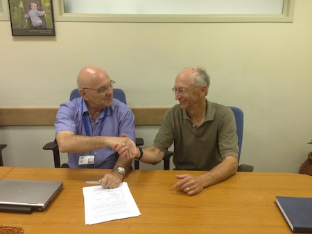 Jeffery Bellson, HP Indigo management, signs the CTL contract with Micheal Dums, Intertek's SATELLITE™ Data Acceptance Program lead auditor.